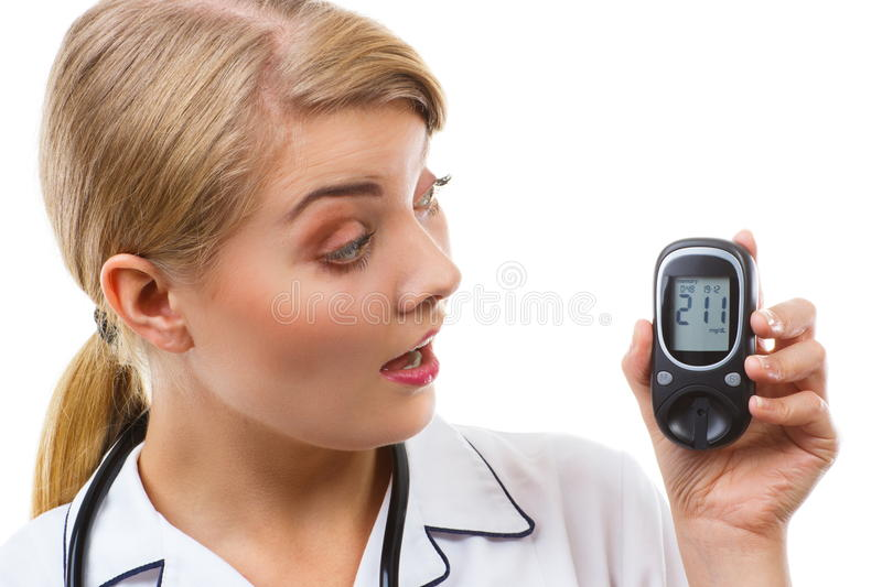 Shocked woman looking at glucometer, measuring and checking sugar level, concept of diabetes. Shocked and worry woman looking at glucose meter with bad result of royalty free stock photography