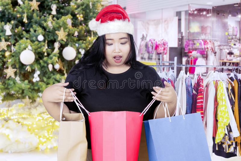 Shocked woman with shopping bag in the mall royalty free stock image