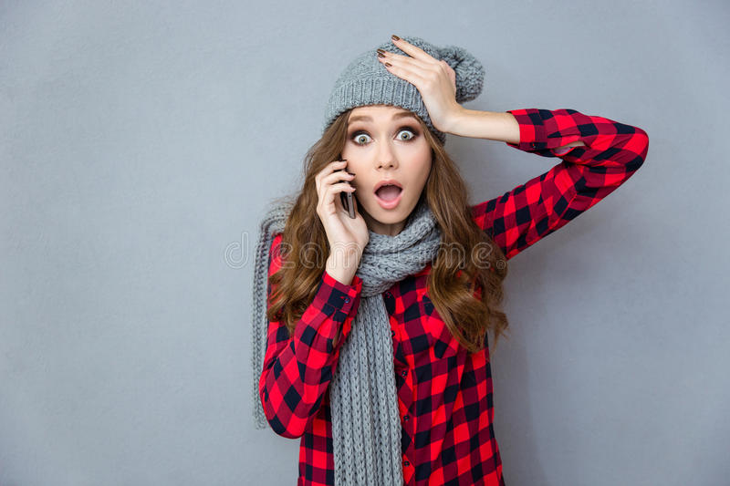 Shocked woman talking on the phone royalty free stock image