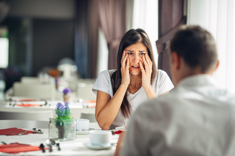 Shocked woman handling bad news,not believing negative event.Stressed crying female having relationship problems.Scandal royalty free stock image