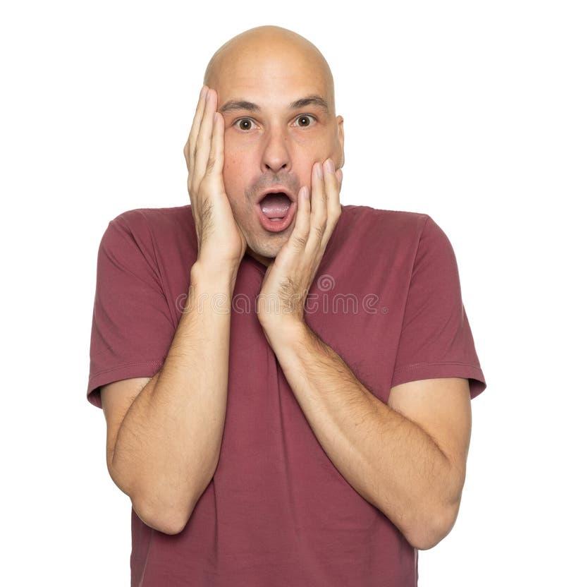 Shocked 40 years bald man. Isolated on white stock photo