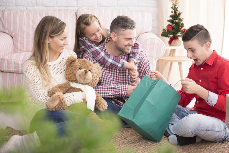 Shocked young boy in christmas stock photo