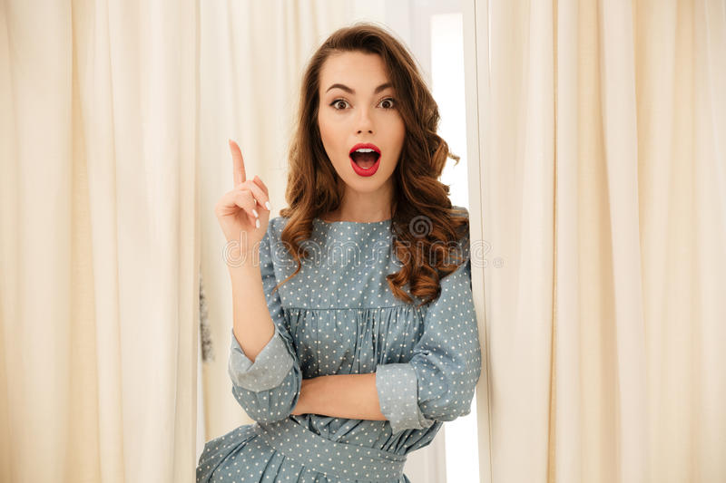 Shocked young lady standing in fitting room royalty free stock photography