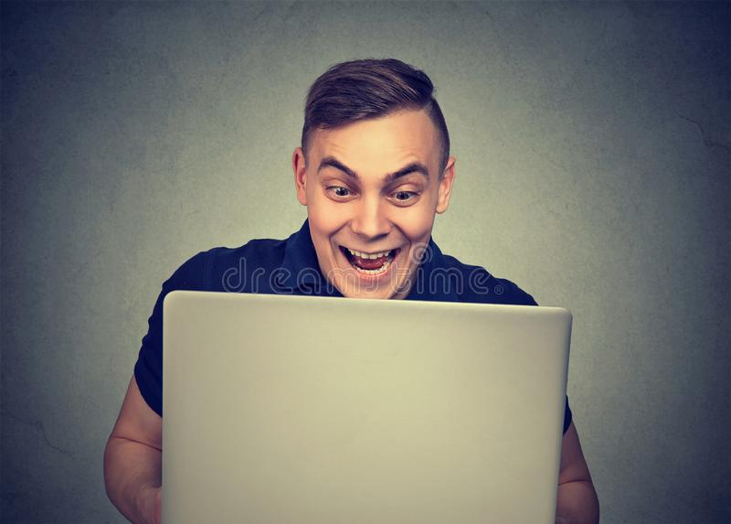 Shocked young man with laptop royalty free stock photography