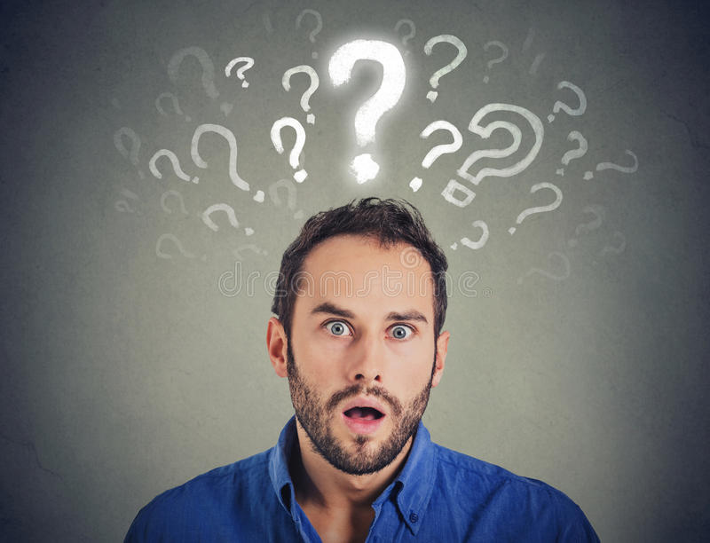Shocked young man with many questions and no explanation or answer. Shocked man with many questions and no explanation or answer royalty free stock photography