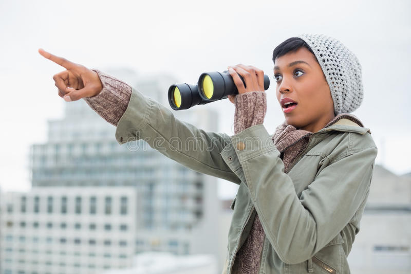 Shocked Young Model In Winter Clothes Showing Something In The Sky Stock Image