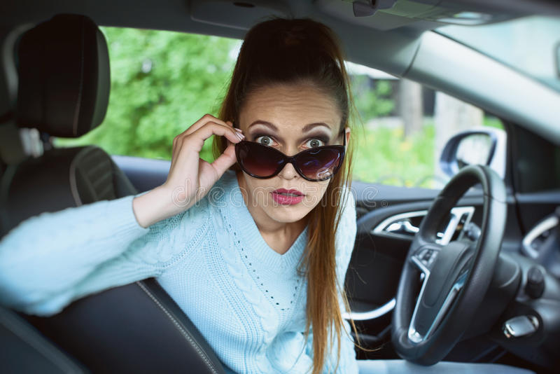 Shocked young woman in the car royalty free stock photography