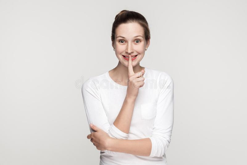 Shocked young woman, showing shh sing royalty free stock photos
