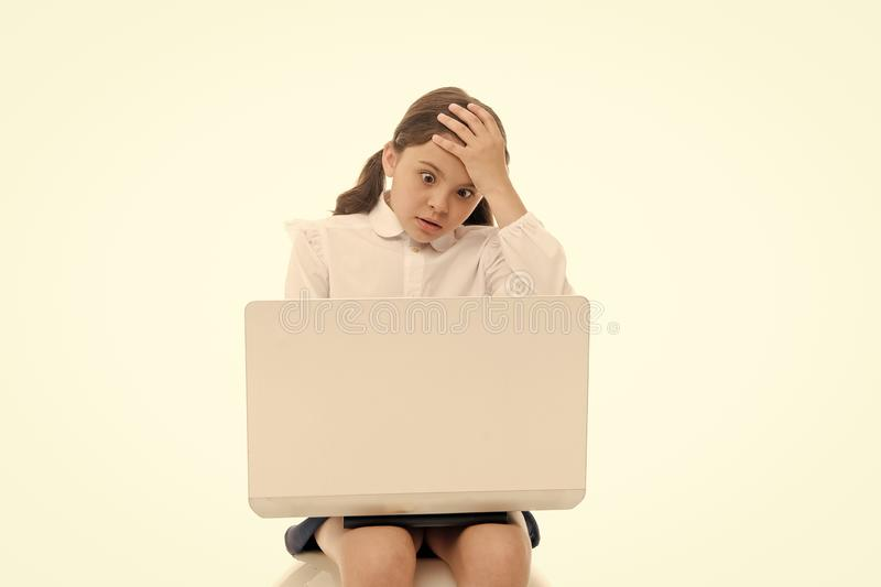 Shocking content. Schoolgirl surfing internet with shocked face. Girl stunned expression touch her head. How can it be royalty free stock images