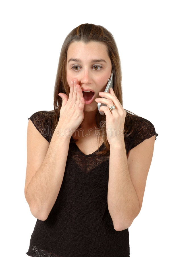 Shocking News. Woman recieves shocking news on her cell phone stock image