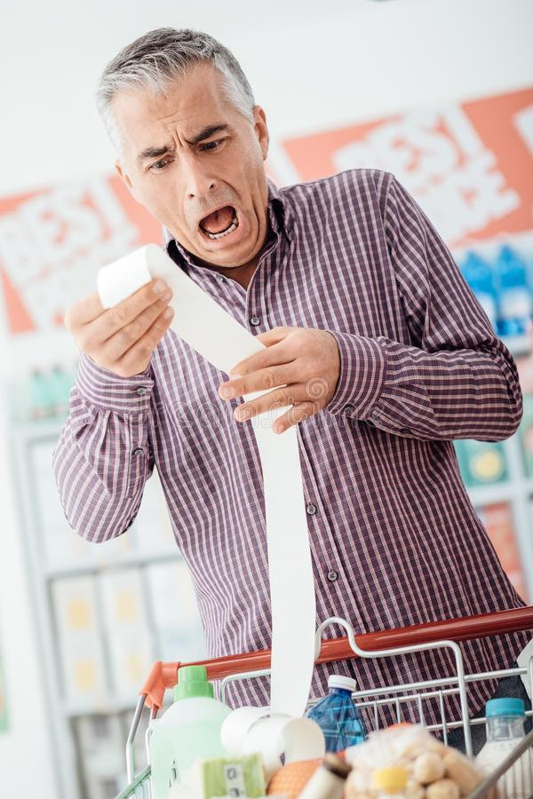 Shockingly dure kruidenierswinkel stock foto