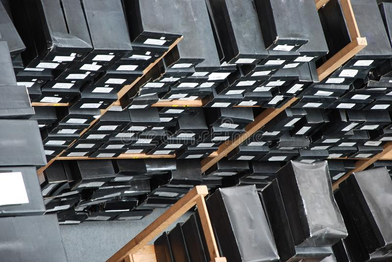 Shoe Boxes. Stacks of black shoe boxes on the shelves storage royalty free stock images