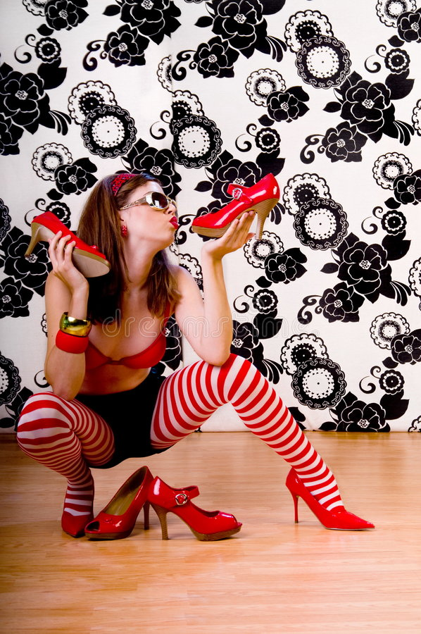 Shoe Fetish. Beautiful young woman with shoe fetish kissing her high heels stock photos