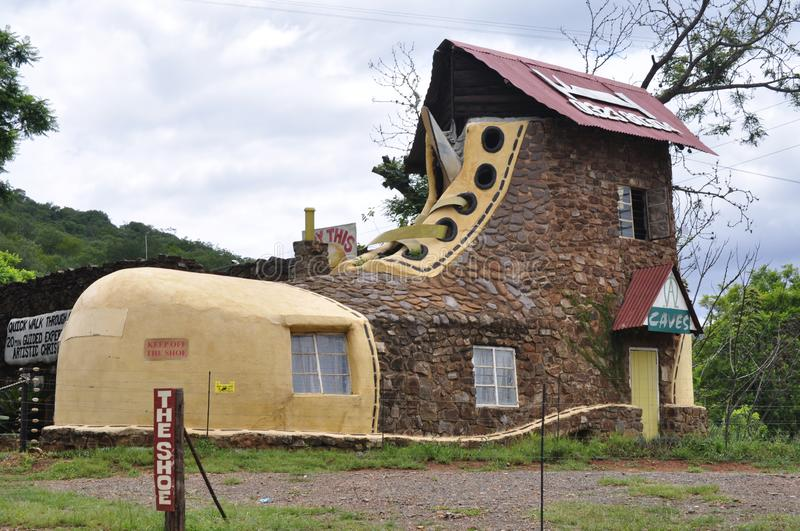 The Shoe House, Limpopo, South Africa. Exterior of tourist attraction The Shoe house in Limpopo, South Africa against blue skies royalty free stock image