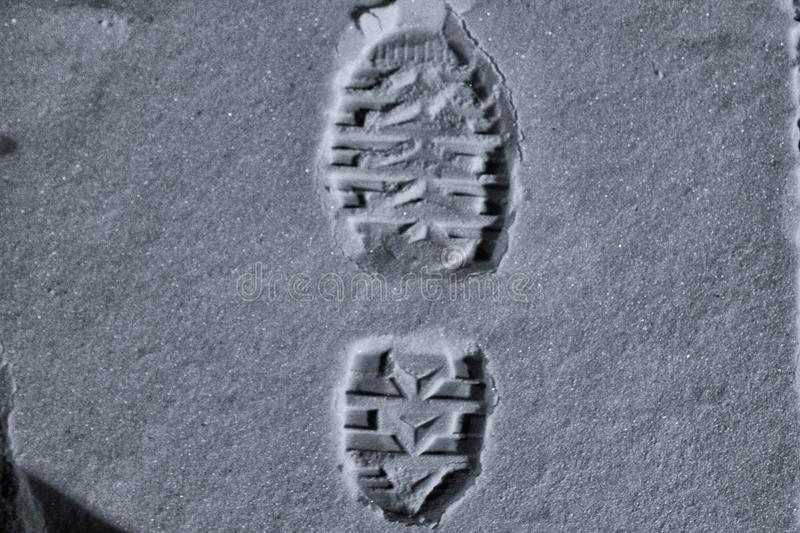 Shoe imprint with a deep contrast royalty free stock photo