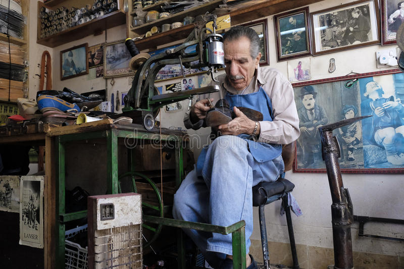 Shoe maker. Shoe repaire old man inside his workshop