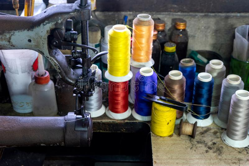 shoe maker work place with sewing leather stock images