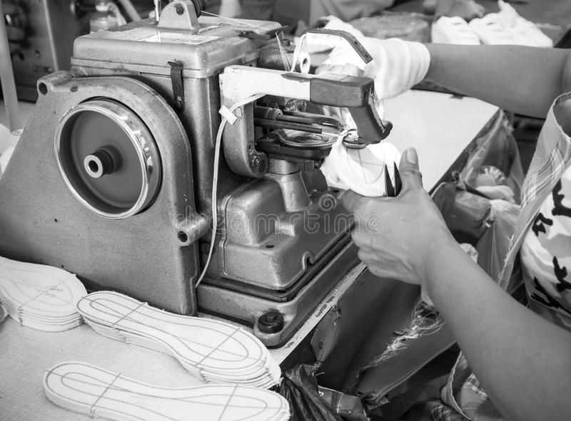 Shoe making process by sewing machine stock photography