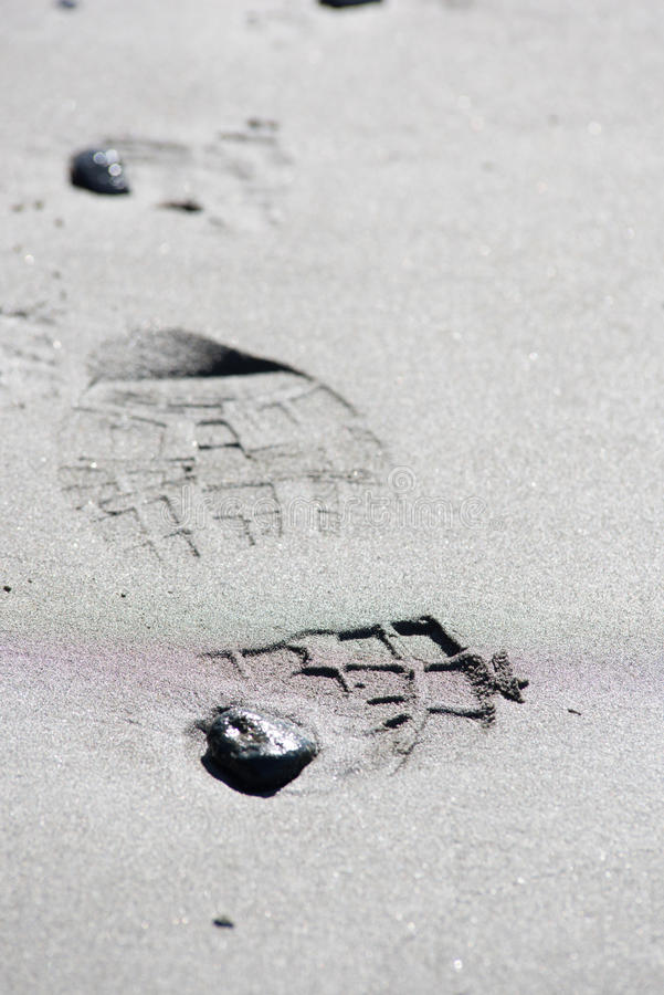 Shoe prints in the sand stock photos