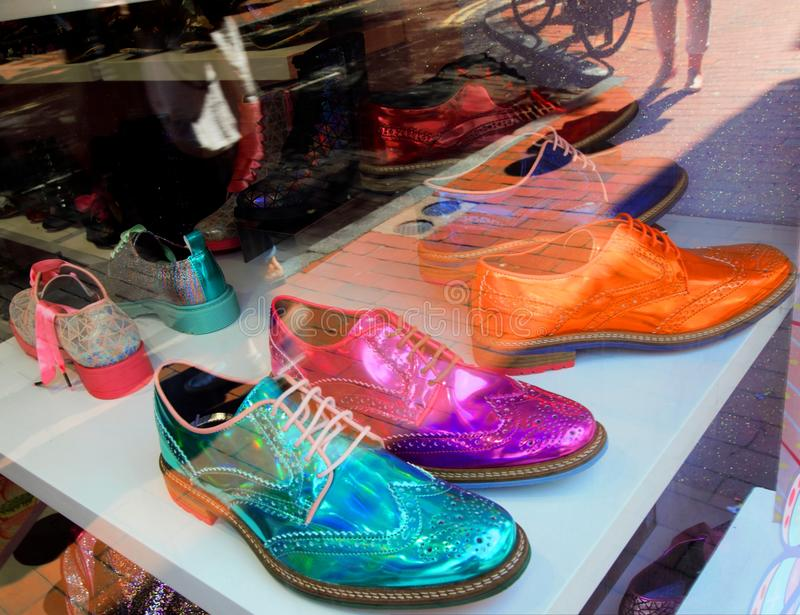 Shoe Shop in Brighton, United Kingdom. Brighton, United Kingdom - August 25, 2018: Shoe shop in Brighton United Kingdom with brightly colored shoes in window and royalty free stock photo