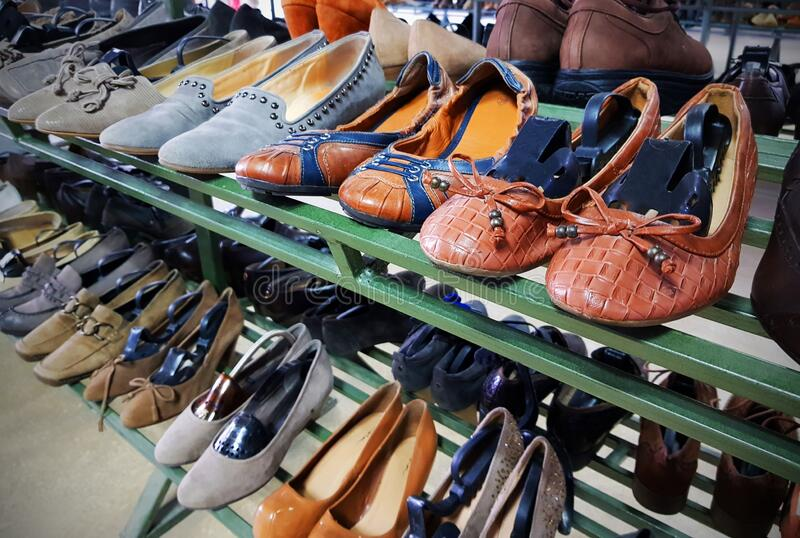 Shoe store. Pairs of shoes. Magazin pantofi incaltaminte. Shoe store. Pairs of shoes, arranged on stander, new or second hand stock images