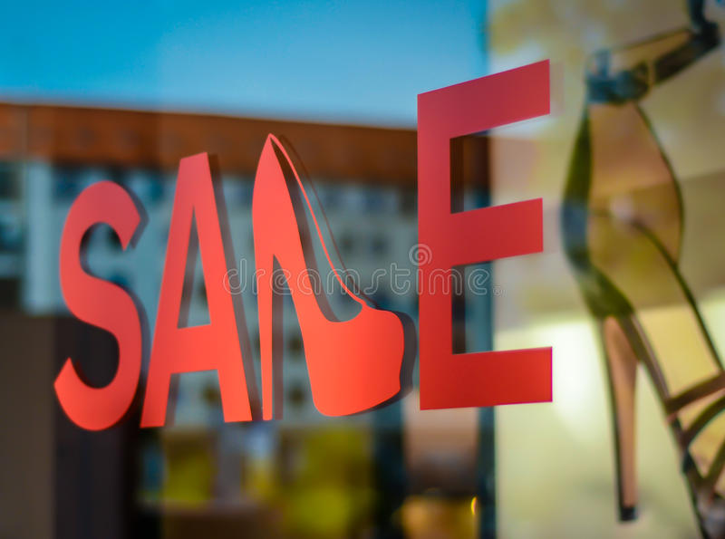 Shoe Store Sale Sign. A Sale Sign In A Shoe Store Window royalty free stock photo