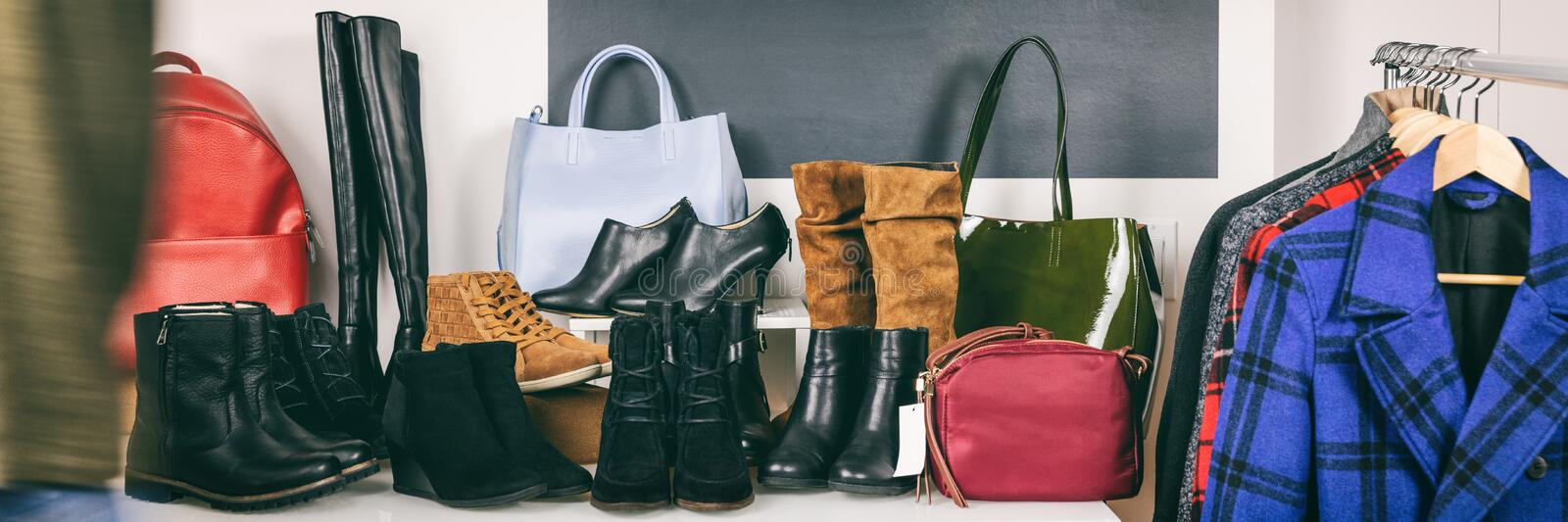 Shoe store shopping mall sale people choosing winter boots at shop banner panorama of shoes and purses on shelves. Blackboard in. Background with autumn bags stock photo