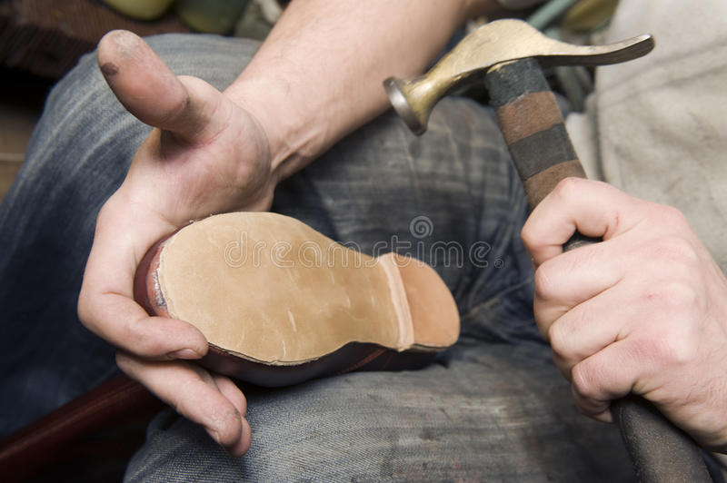 Shoemaker. Is repairing leather shoe stock photos