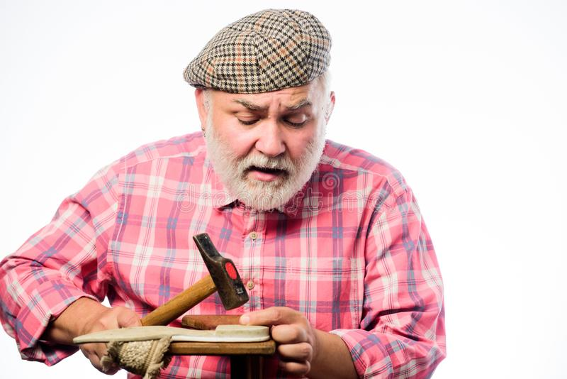 Shoemaker working with leather textile and hammer at workshop. mature shoemaker in workshop make shoes. Cobbler. Workmanship. retro man repair shoes with hammer royalty free stock photos