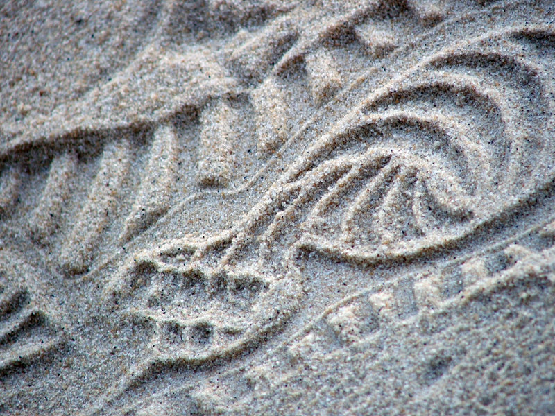 Shoeprint in sand stock photography