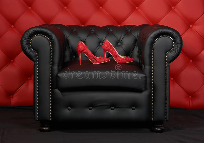 Shoes on the armchair royalty free stock image