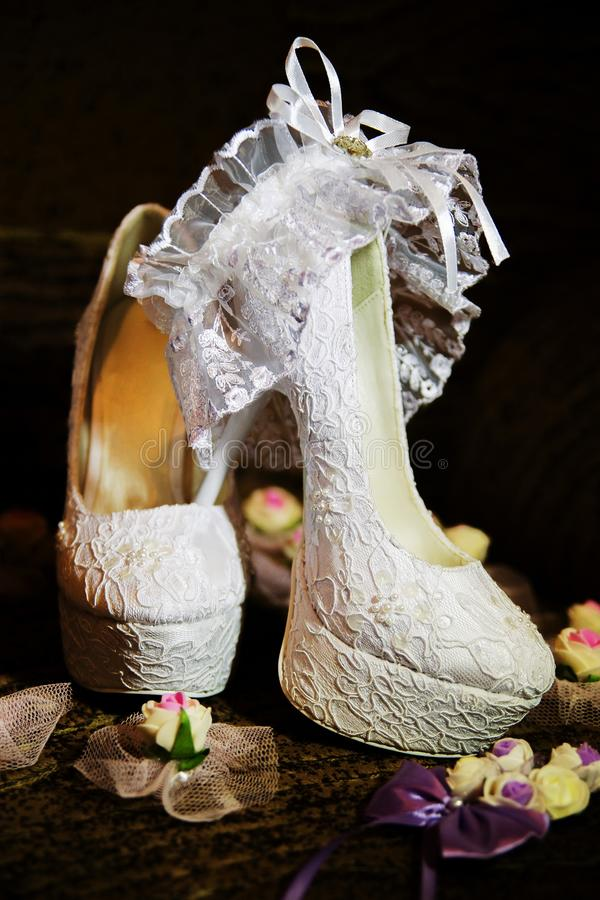 Shoes. Beautiful white wedding shoes with high heels stock images