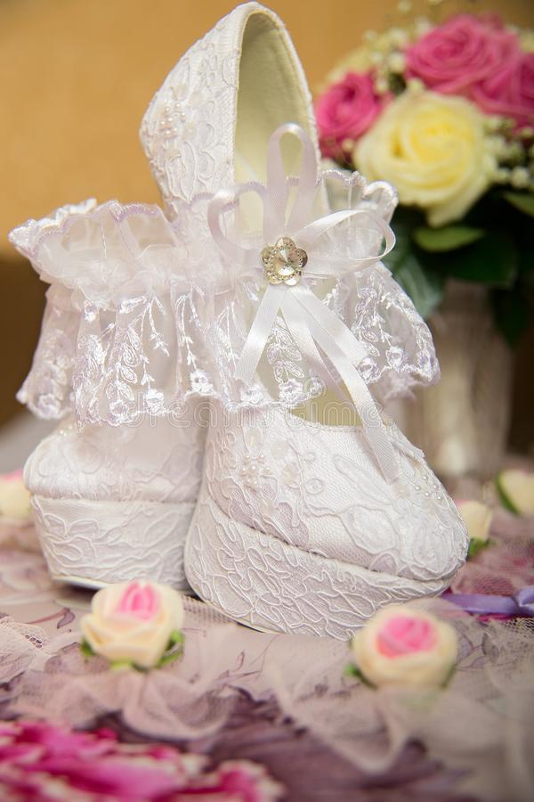 Shoes. Beautiful white wedding shoes with high heels royalty free stock image