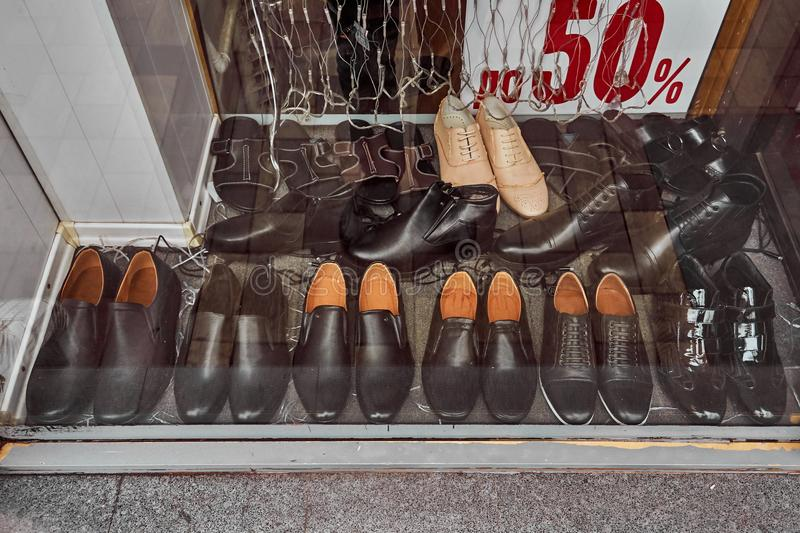 Shoes behind the glass on the old counter royalty free stock photos