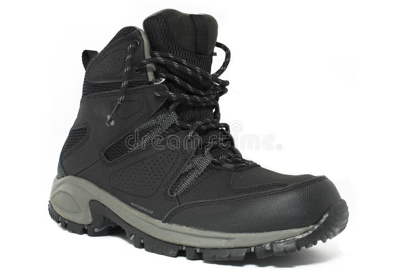 Shoes. Black outdoor hike boot shoes for men, isolated royalty free stock photography