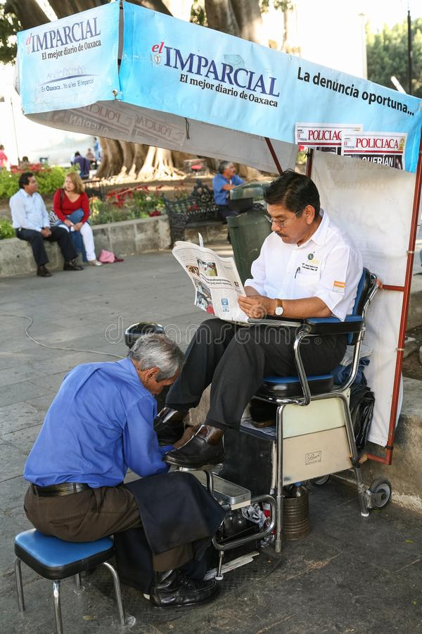 Shoes cleaning service on a street in Oaxaca stock images