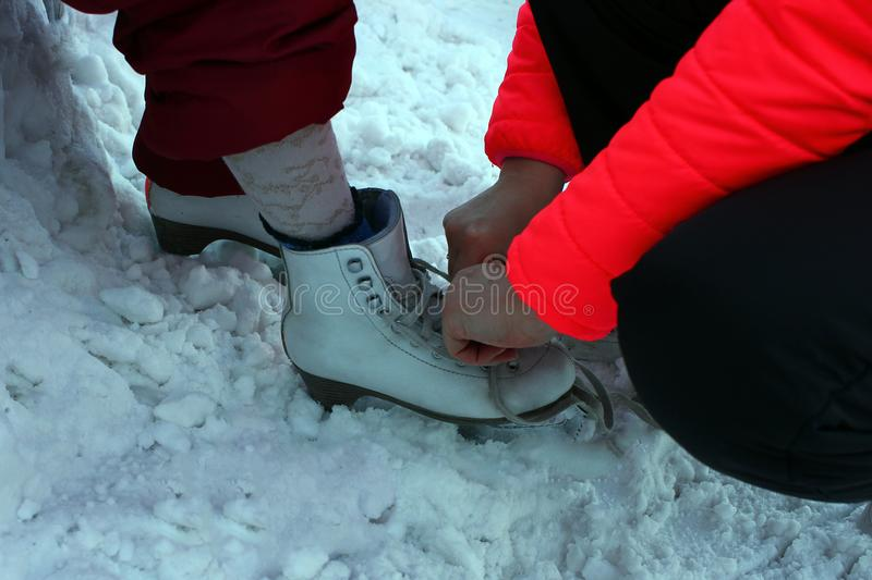 Shoes close-up skating on an ice skating rink. Outdoors, skating on an ice skating rink royalty free stock photography