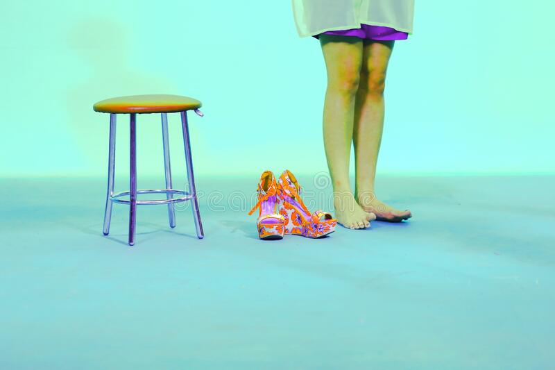 Shoes colored center chair legs woman scene. Shoes colored center chair and legs woman scene video clip performance royalty free stock photos