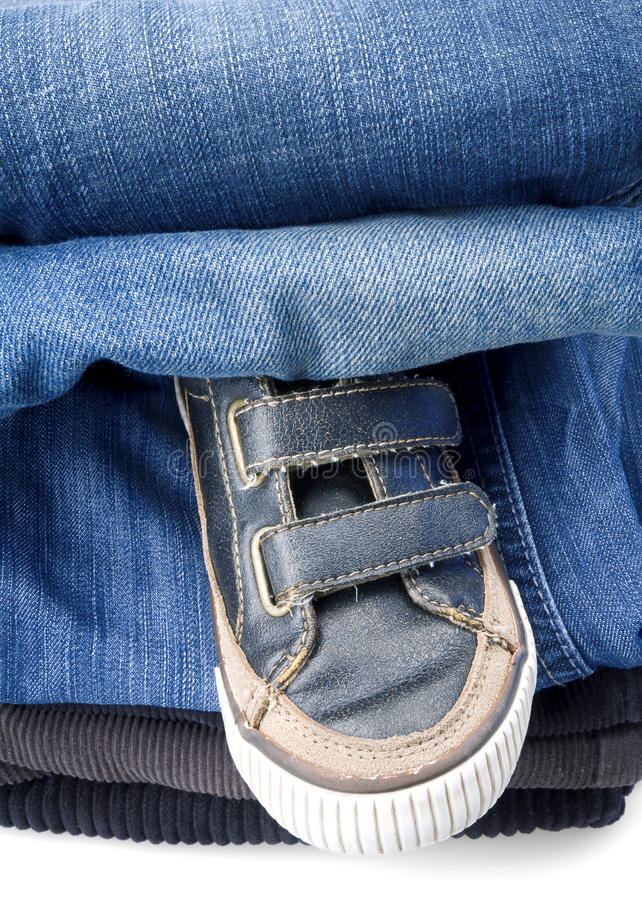 Shoes and denim pants royalty free stock photo