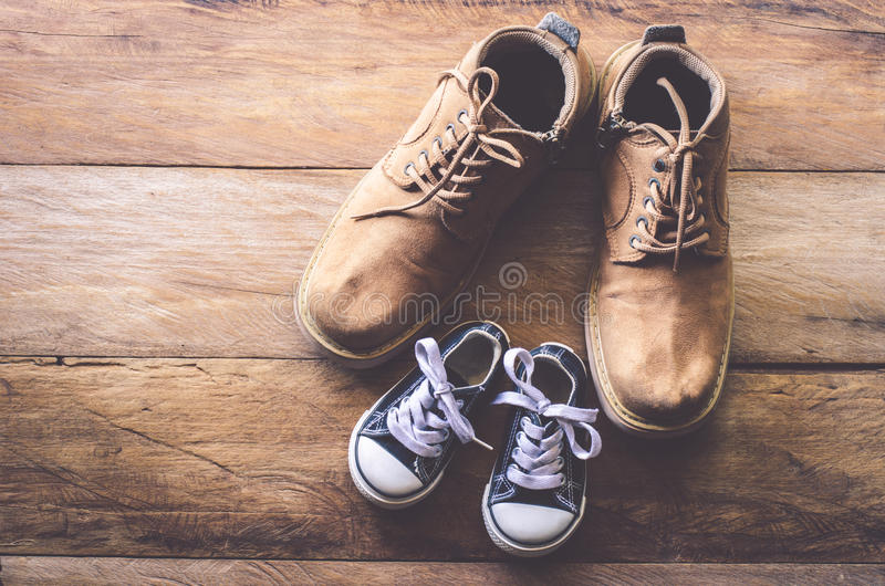 The shoes of father and son - concept take care stock photos