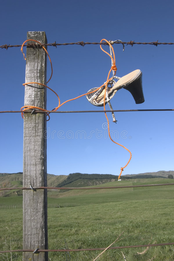 Shoes On Fence Stock Photos