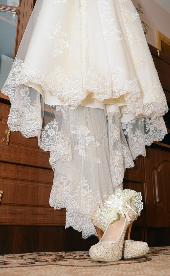 Shoes with garter and dress for bride royalty free stock photo