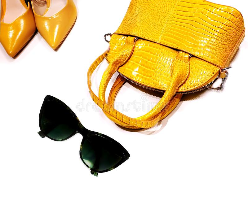 Shoes and handback yellow leather season trends fashion women accessories clothes design luxury stylish foot wear. Shoes and handbag yellow leather season trends stock image