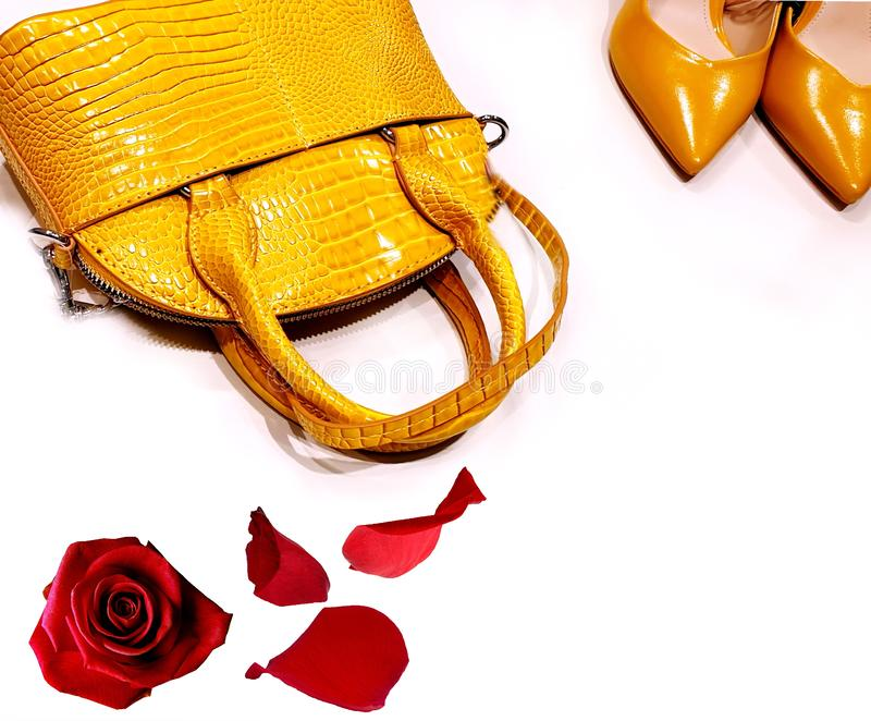 Shoes and handback yellow leather season trends fashion women accessories clothes design luxury stylish foot wear. Shoes and handbag yellow leather season trends royalty free stock photos