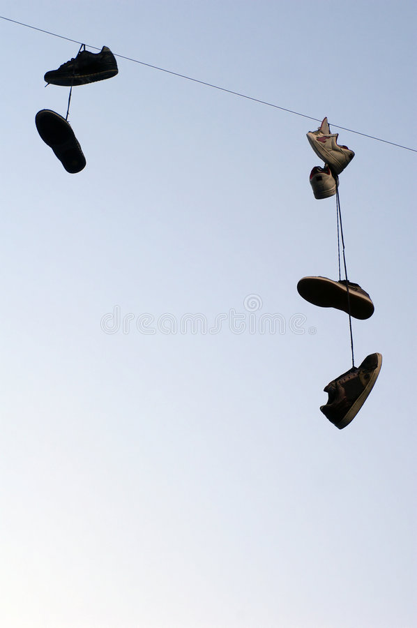 Free Shoes Hanging On A Cable Royalty Free Stock Images - 3373609