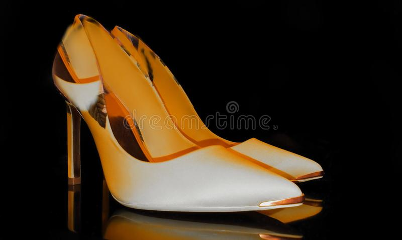Shoes on high heels luxury yellow leather season trends fashion women accessories clothes design luxury stylish foot wear. Black background Shoes and handbag stock images