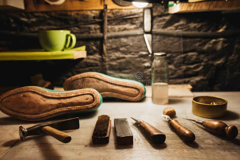 Shoes And Instruments On Table At Footwear Workshop. Stock Image ...