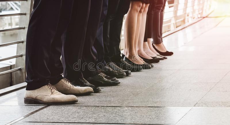 Shoes and legs of businessmen stand together. Successful Business Concepts. royalty free stock image