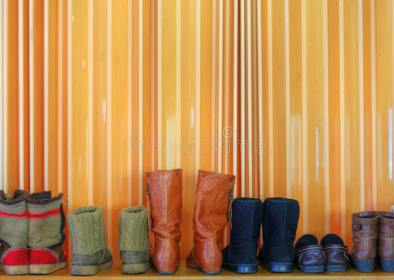 Shoes in line. Variety styles of shoes in winter season stock photography