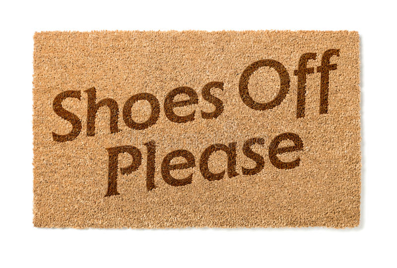 Shoes Off Welcome Mat On White. Shoes Off Welcome Mat Isolated On A White Background stock images